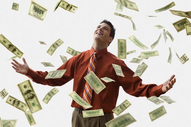 money-falling-on-happy-businessman